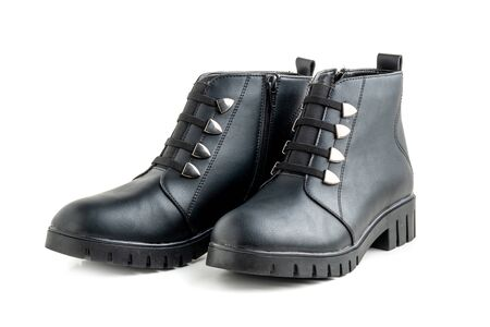 Black Leather female boots with buttons and zipper on white background