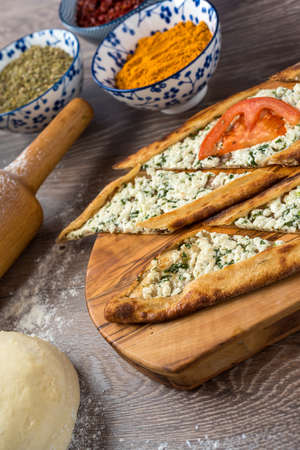 Traditional turkish baked dish pide. Turkish pizza pide, Middle eastern appetizers. Turkish cuisine. Top view. Pide with cheese filling. Imagens