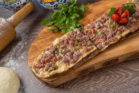 Traditional turkish baked dish pide. Turkish pizza pide, Middle eastern appetizers. Turkish cuisine. Top view. Pide with meat filling