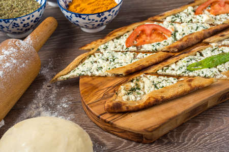 Traditional turkish baked dish pide. Turkish pizza pide, Middle eastern appetizers. Turkish cuisine. Top view. Pide with cheese filling Imagens
