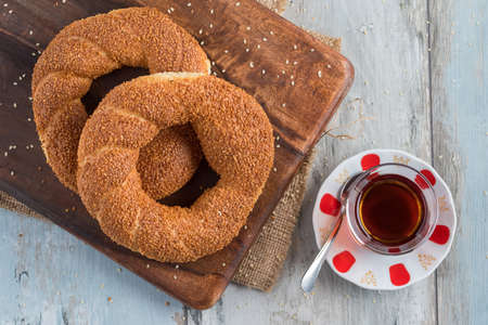 Turkish bagel, simit, and traditional turkish tea on a table