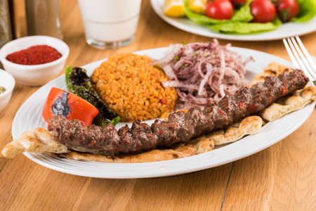 Turkish Adana Kebab with Vegetables on wooden table