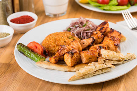 Traditional Turkish grilled Chicken shish kebab with vegetables grilled on skewers. Stock fotó - 155450719