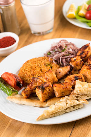Traditional Turkish grilled Chicken shish kebab with vegetables grilled on skewers. Stock fotó - 155450587