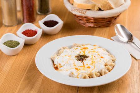 Turkish Pasty or Manti Manlama / Ravioli with yogurt and fried butter sauce Stock fotó - 155450710