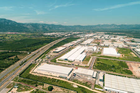 aerial top view photo of modern industrial zone settled by the highway