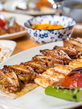 Turkish cuisine chicken wings grill. Grilled chicken wings on wooden background