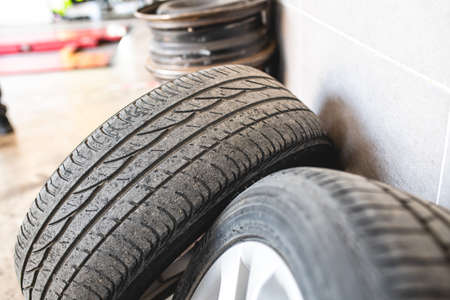 Old car tires at the tire repair shop. Selective focus