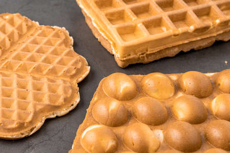 Three different waffles in square, heart and bubble shape. Banque d'images