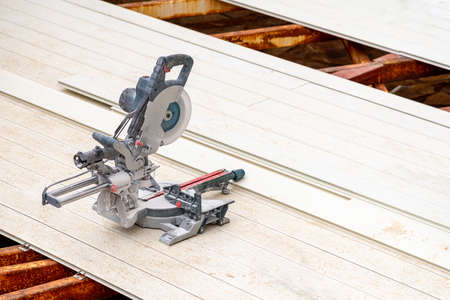 circular saws standing on the assembled composite Deck