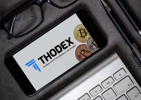 Antalya, Turkey - April 21, 2021: Thodex logo and bitcoin view on the smartphone.