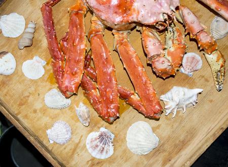 Seashells and crab sea on wooden board