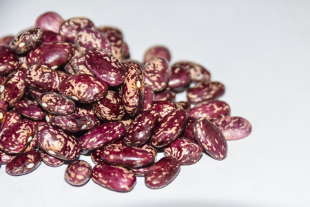Red beans in speckled texture background abstraction macro agro culture Stock Photo