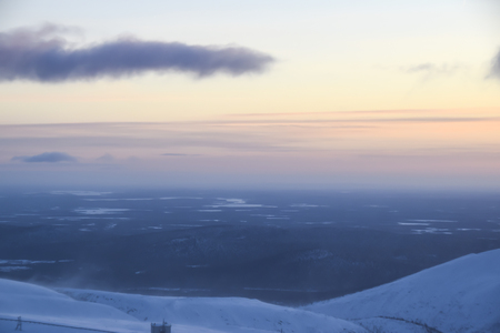 sunset in the mountains in the tundra everywhere white snow nobody landscape Фото со стока