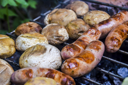 barbecue on  nature in summer mushrooms meat sausages kebab grilled over charcoal