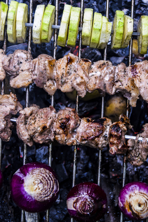 barbecue outdoors  summer meat kebab grill zucchini red onion