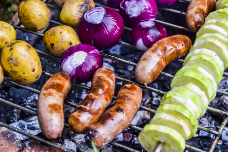 barbecue outdoors summer mushrooms zucchini red onions meat sausages kebab grilled over charcoal