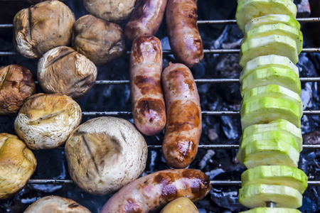 barbecue on  nature in summer mushrooms zucchini meat sausages kebab grilled over charcoal