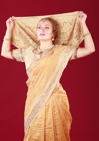 young beautiful woman in the indian national dress photo