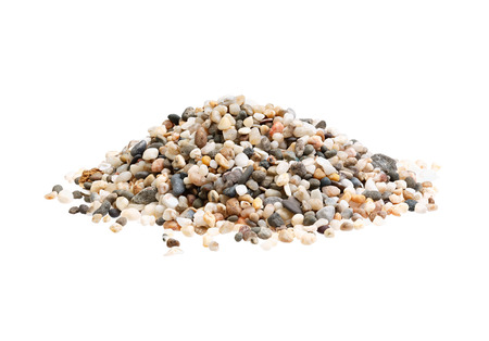 granular: Pile of sand quartz mix with small stones granular isolated on white. Stock Photo