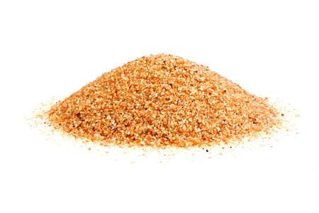 Pile of coarse sand isolated on white background.