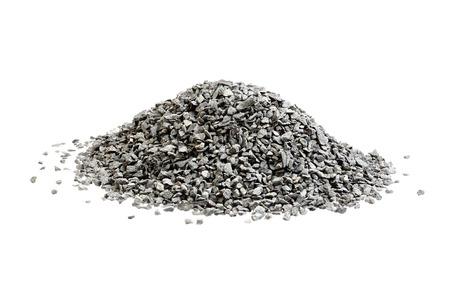 basalt: Pile of small basalt stones stacked on white.