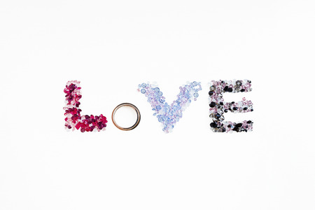 The inscription love of the wedding rings with diamonds (ruby) Stock fotó