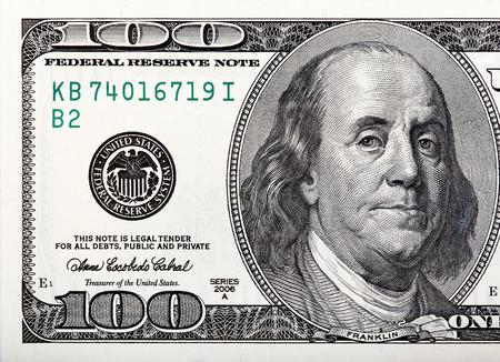 benjamin: Benjamin Franklin on the bill. Macro shot of a 100 dollar.