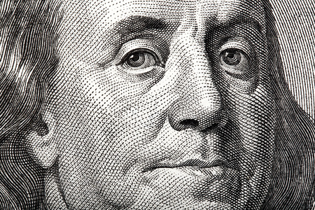Portrait of Ben Franklin on the US $100 dollar bill in macro.