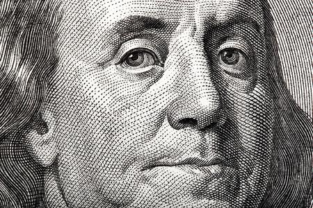 ben franklin money: Portrait of Ben Franklin on the US $100 dollar bill in macro.