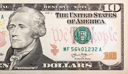 Part of ten dollar bill – American money.