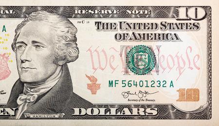 Part of ten dollar bill – American money.