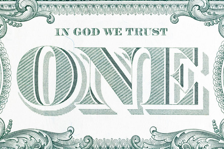 jesus word: In God we trust - banknote one dollar close-up.