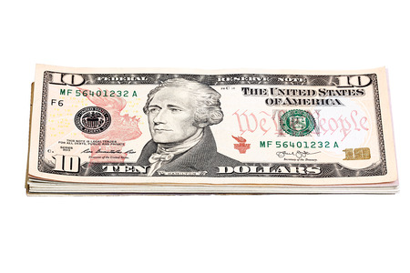 one hundred and ten: Stack of United States currency background - ten dollar bills.