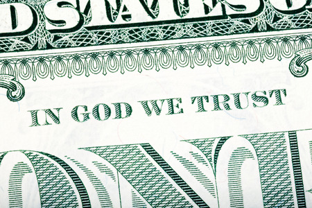in god we trust: Dollar macro, stacked close-up detail photo. In God we trust sentence visible. One-dollar bill fragment. U.S. Treasury.