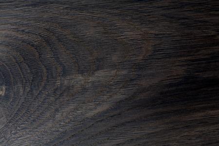 Detailed close-up of black wood (oak) texture background. Stock fotó