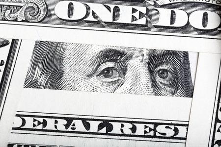 ben franklin money: Close-up of one hundred bill Franklin portrait framed by other bills.