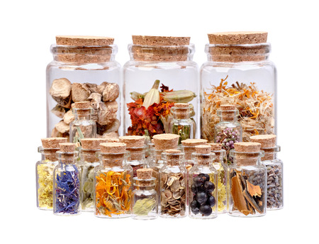 calamus: Herbal tea dried herbs flowers and berries in glass bottles for medical use isolated on white.