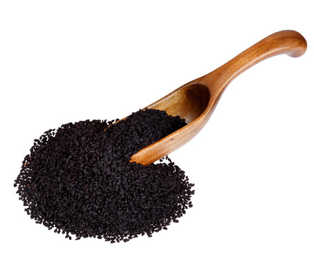 Nigella or Black cumin in the wooden spoon, isolated on white background.