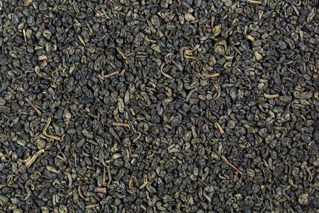 gunpowder tea: Background of green gunpowder tea. Stock Photo