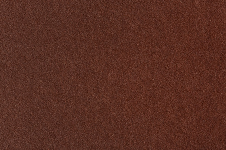 torn paper background: Closeup of abstract grunge brown paper background. Stock Photo
