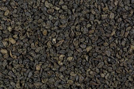 gunpowder: Background texture of dried, green, gunpowder tea.