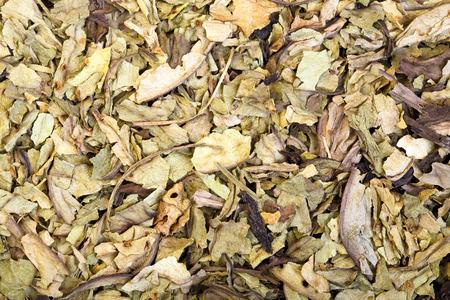 crumbled: Pile of dry crumbled plantain Plantago lanceolata medicinal herb.