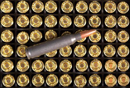 full metal jacket: Ammunition cartridge on background. Stock Photo
