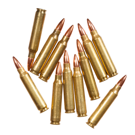 full jacket bullet: 5.56x45mm intermediate cartridges isolated on white. Stock Photo