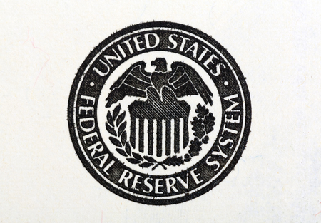 us dollar: Macro shot of United States Federal Reserve System symbol on old 100 dollar bill. Stock Photo