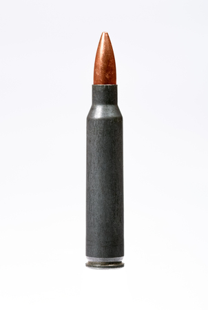 full jacket bullet: Single rifle bullet over white.