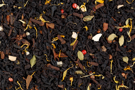 cardamum: Decorative full frame image of cloves, cardamom, cinnamon,ginger and black tea. Masala tea.