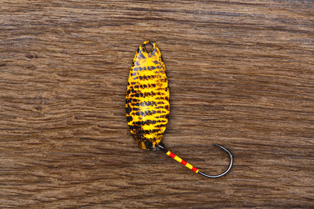 trout fishing: Yellow bait for trout fishing on the old wooden table.