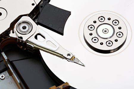 disk drive: Hard disk drive inside. Data safety concept. Stacked photo.